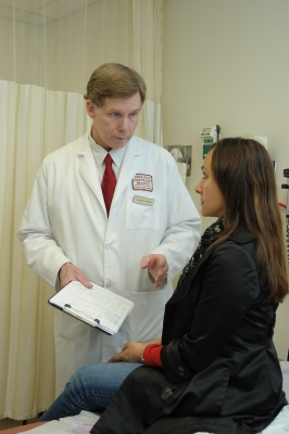 Marston Linehan, M.D., discusses treatment with a patient.