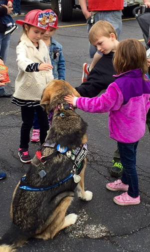 Kids meet a fire rescue dog.