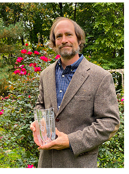 Eric O. Freed, Ph.D., holding 2020 Distinguished Research Career Award from The Ohio State University Center for Retrovirus Research