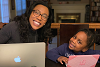 Sadhana Jackson and daughter at computer