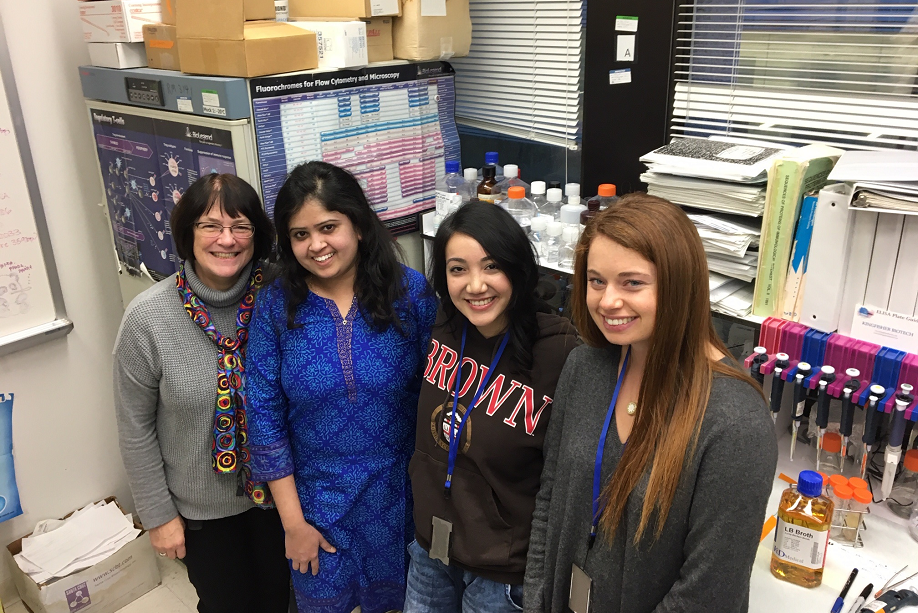 Dr. Bev Mock and three trainees in the lab