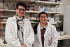 Dr. Esta Sterneck and a trainee in the lab