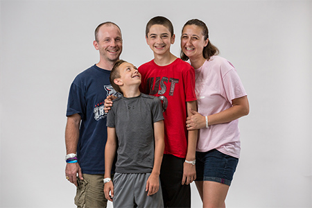 Bryce Werner, center, poses with his family