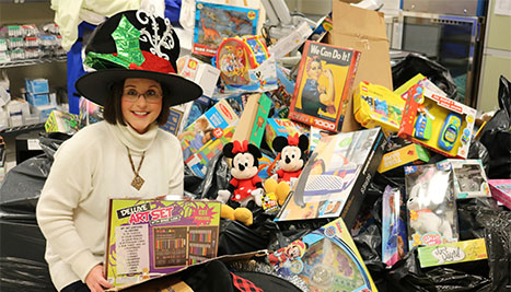 Julie Jones poses with toys