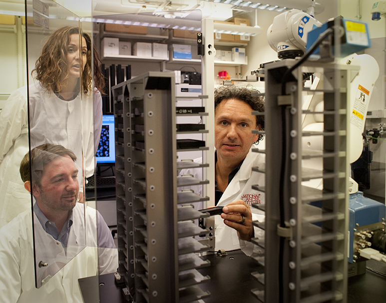 Image of Gianluca Pegoraro, Ph.D., Sigal Shachar, Ph.D., and Tom Misteli, Ph.D., in the lab