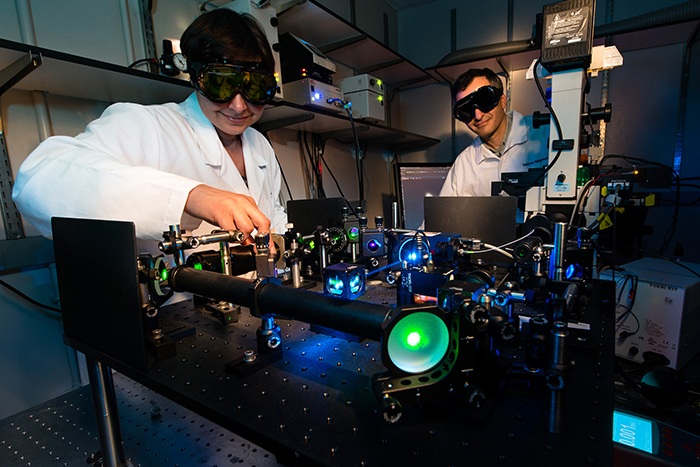 Photo of Jadranka Loncarek, Ph.D., and Valentin Magidson, Ph.D., preparing for laser microsurgery.