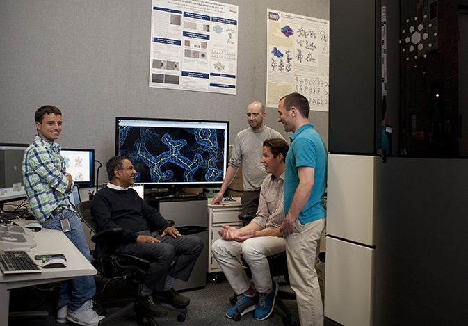 Photo of Sriram Subramaniam and members of his team discussing the Krios microscope with FEI Company representatives. Left to right: Alan Merk, Sriram Subramaniam, Ph.D., Kieran Moynihan, Gijs Janssen, and Joseph Darling, Ph.D.