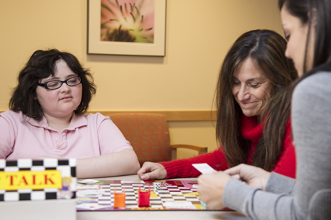 patient and staff playing a board game