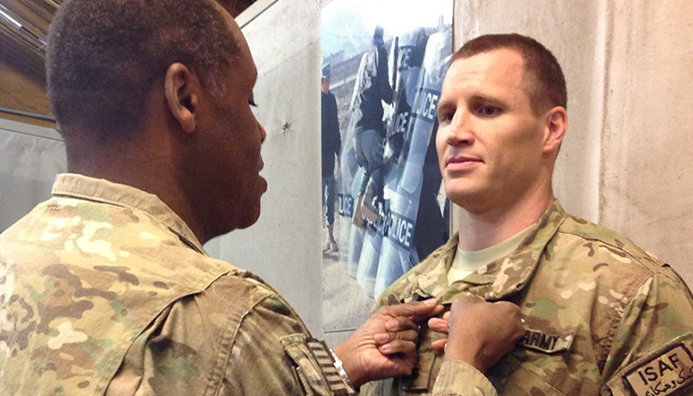 This photo is of Mai in Afghanistan receiving the Bronze Star from Lieutenant General Michael Williamson