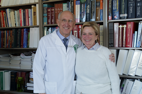 Dr. Steven A. Rosenberg with a patient at the NIH Clinical Center.