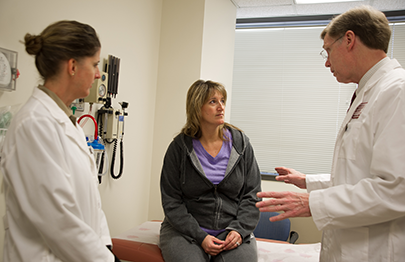 Dr Linehan, staff and a patient discuss options